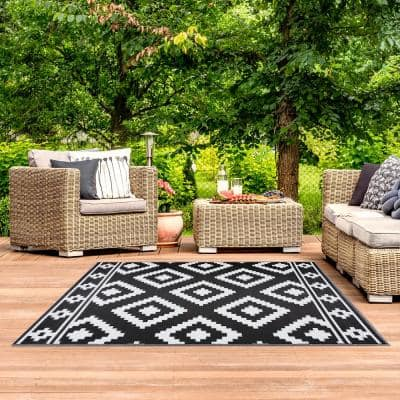 Milan Black and White 6 ft. x 9 ft. Reversable Indoor/Outdoor Recycled,Plastic,Weather,Water,Stain,Fade and UV Resistant