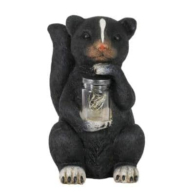 10 in. tall Solar Skunk with LED Firefly Jar Garden Statue