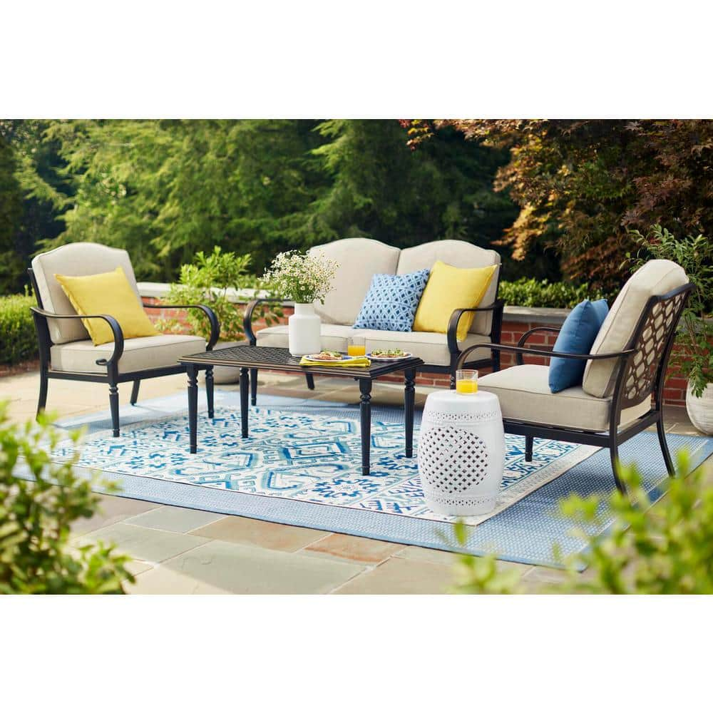 hampton bay laurel oaks 4 piece brown steel outdoor patio conversation seating set with standard putty tan cushions 505 0370 000 the home depot