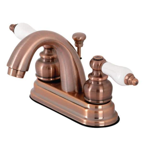 Kingston Brass Restoration 4 In Centerset 2 Handle Bathroom Faucet In Antique Copper Hkb561plac The Home Depot