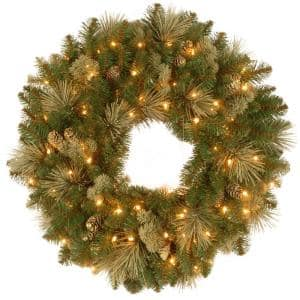 30 in. Carolina Pine Artificial Christmas Wreath with Flocked Cones and 100 Warm White Battery Operated LED Lights