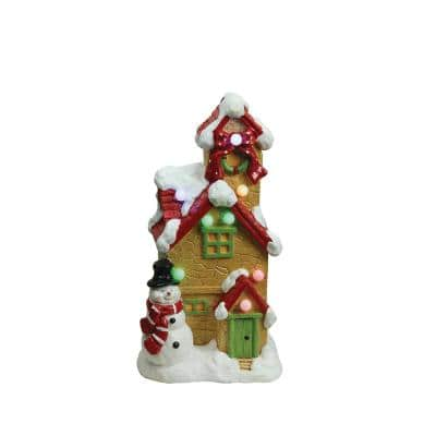 17 in. Christmas Morning LED Lighted Snow Covered Cottage with Snowman Musical Christmas Tabletop Decoration