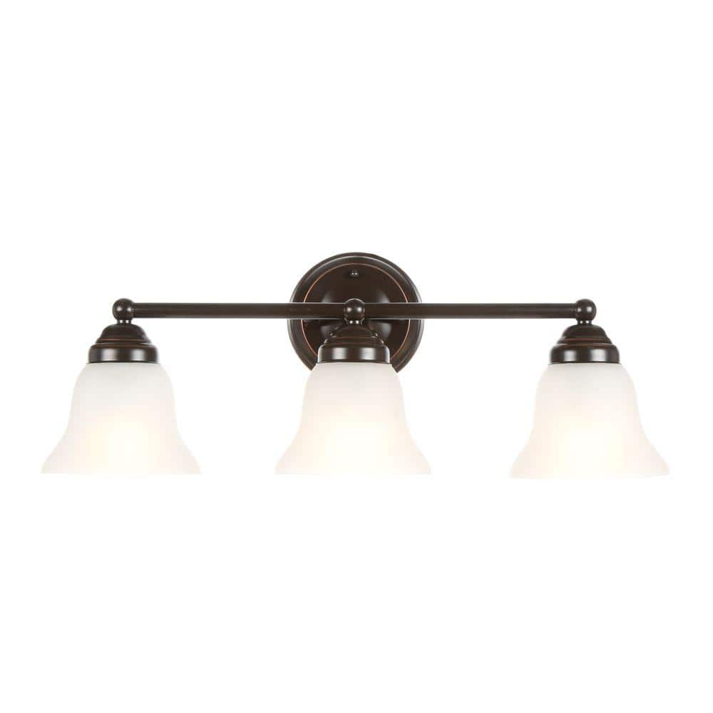 Hampton Bay Ashhurst 3 Light Oil Rubbed Bronze Vanity Light With Frosted Glass Shades Egm1393a 4 Orb The Home Depot