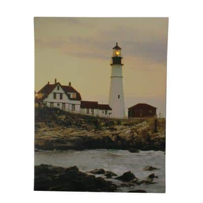 11.75 in. x 15.75 in. LED Cottage and Lighthouse on the Shoreline at Sunset Lighted Canvas Wall Art