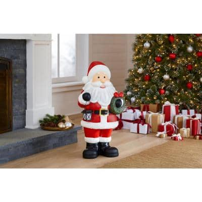 36 in. Christmas Santa Holding Solar Lantern & Wreath
