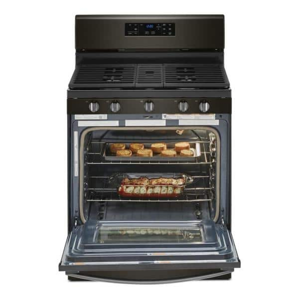 Whirlpool 5 0 Cu Ft Gas Range With Self Cleaning And Center Oval Burner In Black Stainless Wfg525s0jv The Home Depot