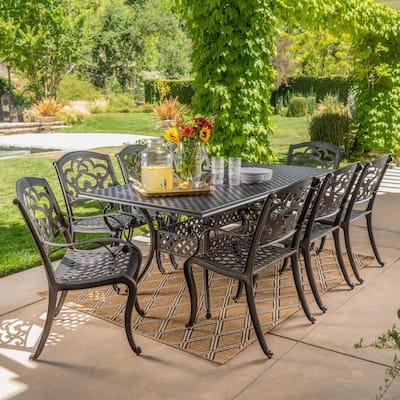 Abigal Shiny Copper Finish 9-Piece Cast Aluminum Rectangular Outdoor Dining Set