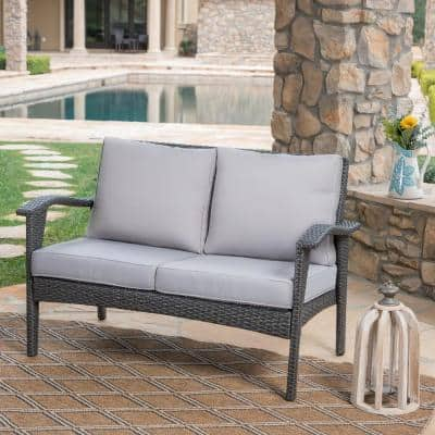 Honolulu Grey Wicker Outdoor Loveseat with Silver Cushions