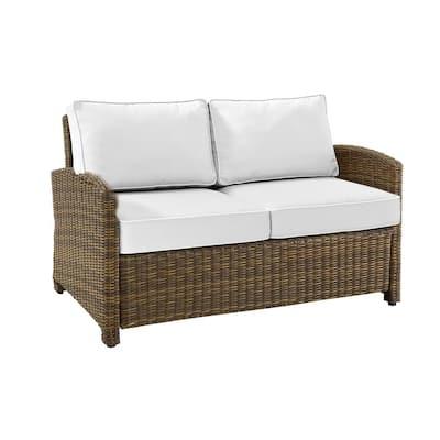 Bradenton Weathered Brown Wicker Outdoor Loveseat with Sunbrella White Cushions