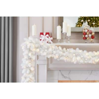 9 ft. Uptown Pre-Lit LED Artificial Christmas Garland with 180 Tips and 100 Warm White Micro Dot Lights