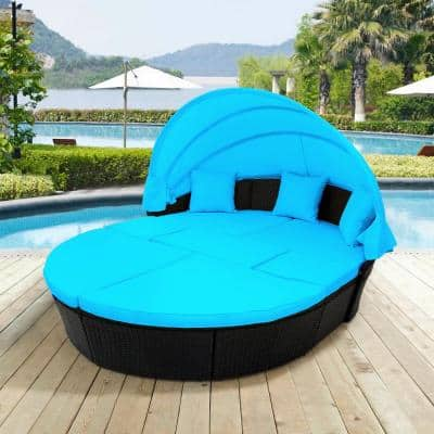 Black Wicker Outdoor Day Bed with Blue Cushions and Retractable Canopy