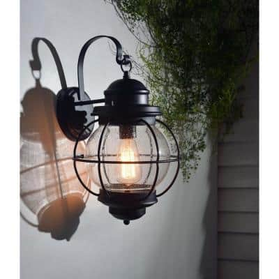 Greer 1-Light Black Exterior Wall Lantern Sconce with Caged Seeded Glass