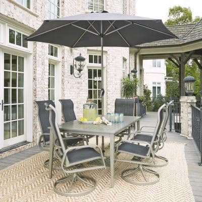 Homestyles Captiva Charcoal Gray 9 Piece Cast Aluminum Rectangular Outdoor Dining Set With Umbrella 6700 31556 The Home Depot