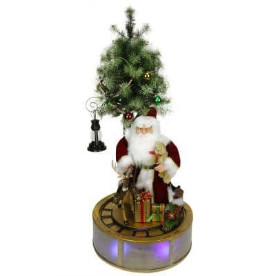 4 ft. Animated and Musical Lighted LED Santa Claus with Tree and Rotating Train Christmas Decor