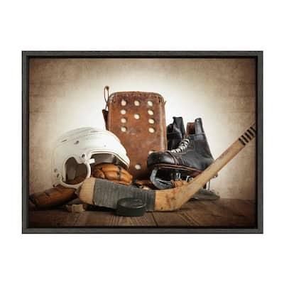 "Sylvie ""Vintage Hockey Gear"" by Saint and Sailor Studios 24 in. x 18 in. Framed Canvas Wall Art"