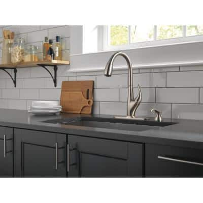 DeLuca Single-Handle Pull-Down Sprayer Kitchen Faucet with ShieldSpray Technology and Soap Dispenser in Stainless