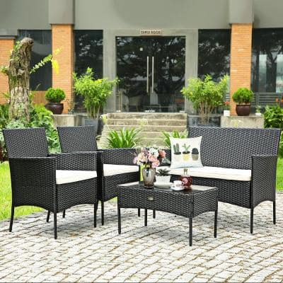 Brown Wicker Outdoor Chaise Lounge with White Cushions