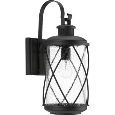 Hollingsworth Collection 1-Light Textured Black Clear Seeded Glass Farmhouse Outdoor Medium Wall Lantern Light