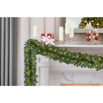 12 ft. Elegant Battery Operated Noble Fir LED Pre-Lit Christmas Garland with Timer and 70-Micro Dot Light