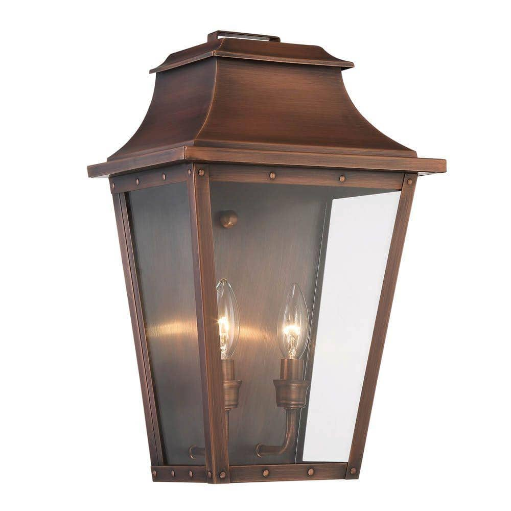 """Coventry collection 2-Light copper patina wall lantern. This style is more on the """"old/rustic"""" tin-looking lanterns that used to be handmade back in the old days. It has a warm look with a glow from the"""