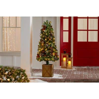 4.5 ft Woodmoore Mixed Pine Potted Pre-Lit Artificial Christmas Tree with 70 Warm White Mini Lights