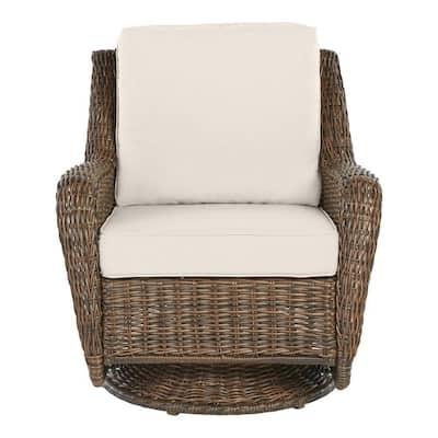 Cambridge Brown Wicker Outdoor Patio Swivel Rocking Chair with CushionGuard Almond Tan Cushions