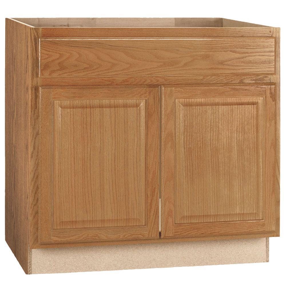 Hampton Medium Oak Raised Panel Stock Assembled Sink Base Kitchen Cabinet (36 in. x 34.5 in. x 24 in.)