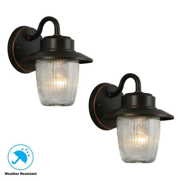 copper finish. Lot of two Hampton bay wall sconces in a oil rubbed bronze
