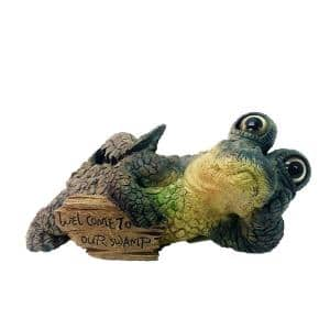 21 in. W Toad Hollow Extra-Large Lying Whimsical Gator with Welcome to Our Swamp Sign Alligator Garden Statue