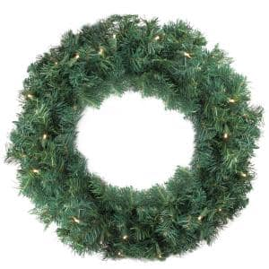 24 in. Pre-Lit Cedar Pine Artificial Christmas Wreath with Warm Clear LED Lights
