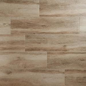Briarwood Walnut 9.84 in. x 39.4 in. Matte Porcelain Floor and Wall Tile (16.14 sq. ft./Case)