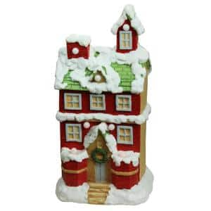 21.25 in. Christmas Morning Pre-Lit LED Snow Covered 2 Story House Musical Christmas Tabletop Figure