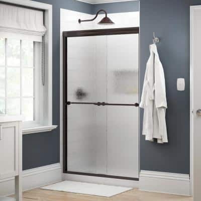 Everly 48 in. x 70 in. Traditional Semi-Frameless Sliding Shower Door in Bronze and 1/4 in. (6mm) Rain Glass