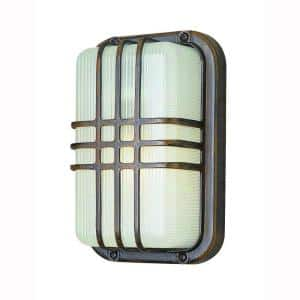 Walker Rust Outdoor Bulkhead Light with Ribbed Acrylic Shade