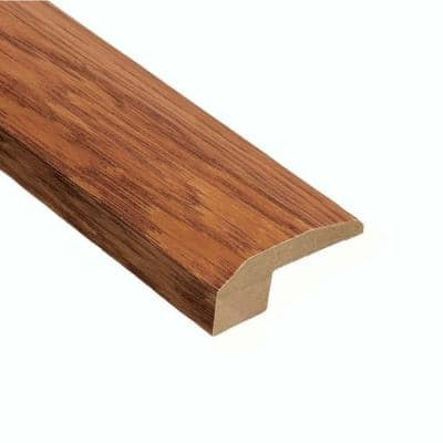 Oak Gunstock 3/4 in. Thick x 2-1/8 in. Wide x 78 in. Length Carpet Reducer Molding