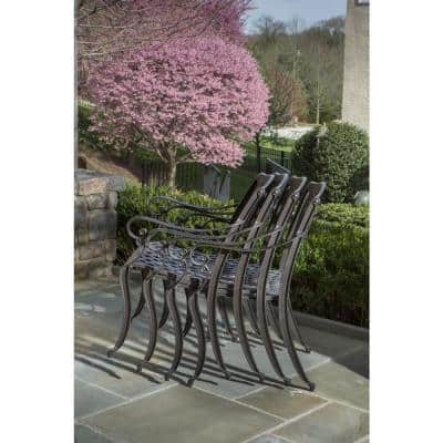 7-Piece Westbury Black Cast Aluminum Outdoor Dining Set with 59 in. Table, Lazy Susan, and 6 Stackable Arm Chairs