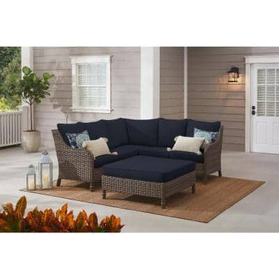 Windsor 4-Piece Brown Wicker Outdoor Patio Sectional Sofa with Ottoman and CushionGuard Midnight Navy Blue Cushions