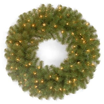24 in. North Valley Spruce Artificial Wreath with Clear Lights