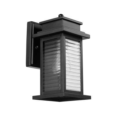 Wayne 1-Light Bronze Outdoor Indoor Wall Lantern Sconce with Clear Ribbed Glass Shade and Incandescent Bulb Included