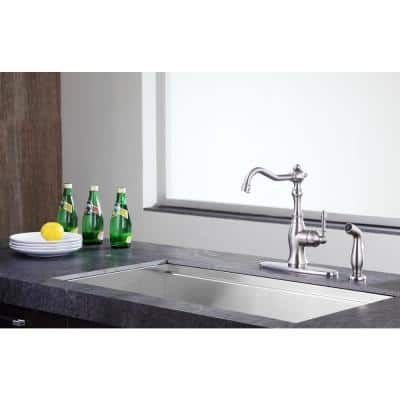 Highland Single-Handle Standard Kitchen Faucet with Side Sprayer in Brushed Nickel