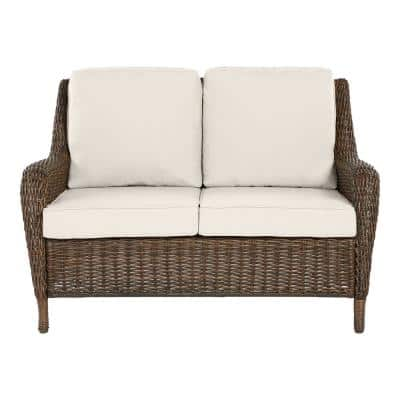 Cambridge Brown Wicker Outdoor Patio Loveseat with CushionGuard Almond Tan Cushions