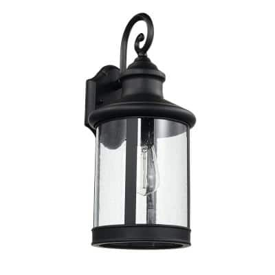 Norman 1-Light Black Outdoor Indoor Wall Lantern Sconce with Clear Seeded Glass Shade and Incandescent Bulb Included
