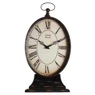 Antique Black Oval Iron Table Clock on Base with a Top Ring