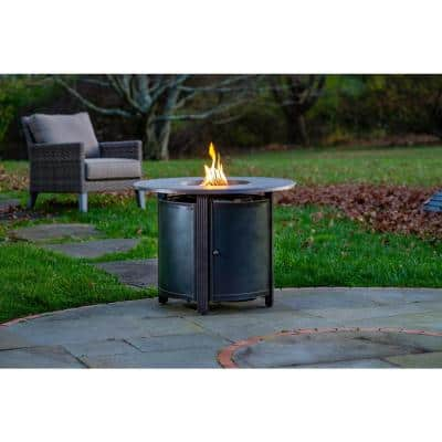 Hartwick 34 in. Outdoor Round Cast Aluminum Gas Fire Pit in Topaz Bronze with Clear Glass Fire Beads