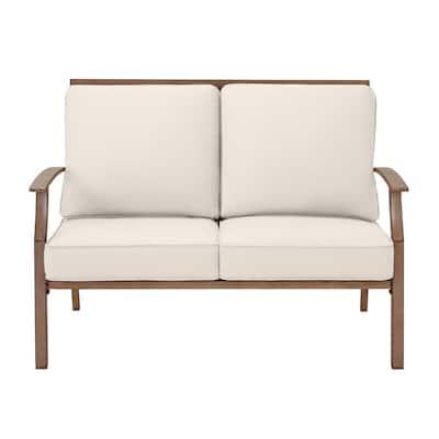 Geneva Brown Wicker Outdoor Patio Loveseat with CushionGuard Almond Tan Cushions