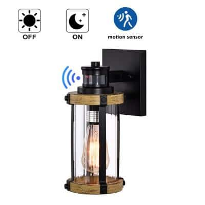 1-Light Black and Woodgrain Motion Sensing Dusk to Dawn Outdoor Wall Sconce with Striped Clear Glass