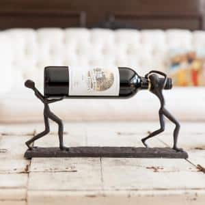 Two Men Carrying a Bottle Cast Iron Wine Holder