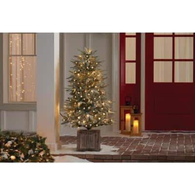 4.5 ft Pre-Lit Potted Artificial Christmas Tree with 100 Warm White Lights